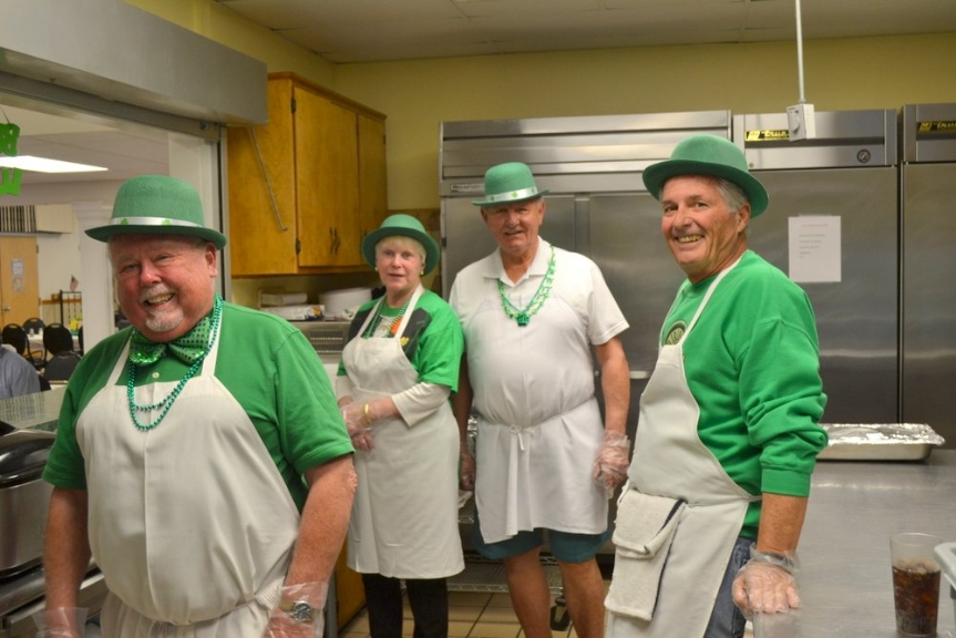 The St. Patrick's Day kitchen crew had the task of preparing the feast.  From left are Jim Stueve, Sue and Stan Burchacki and Dave Gibbons, all dressed for the day.