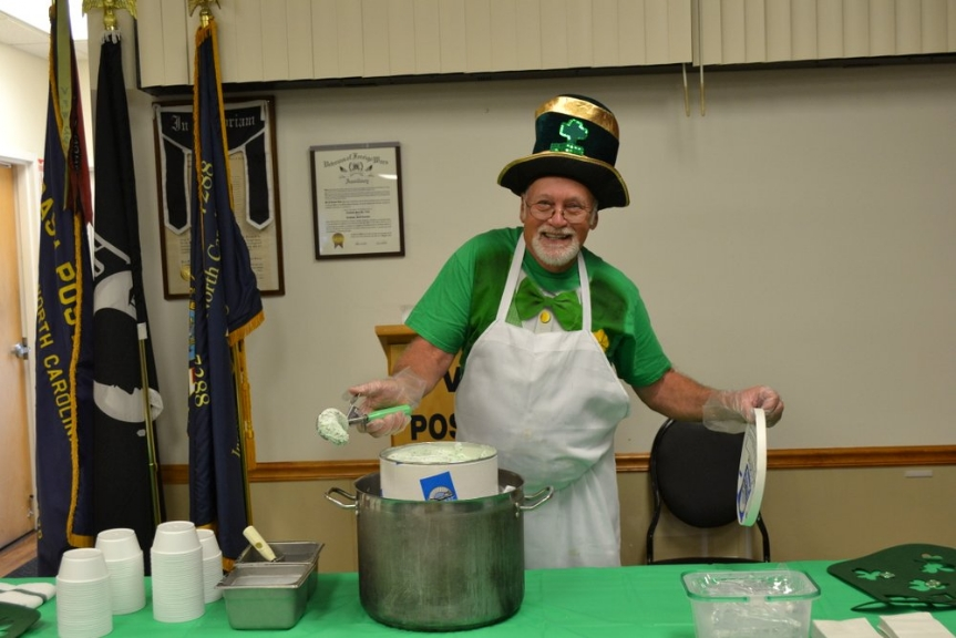 Cliff Hinkley shows off a scoop of Marvel Chocolate Chip Mint ice cream which fit the St. Patrick's Day menu perfectly with its green tint.