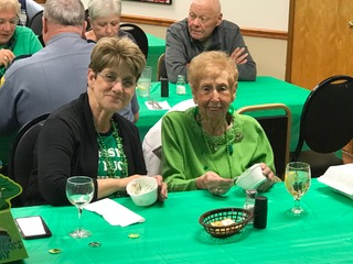 Cathy Milstead (l) and Dottie Hoffman were dressed for the St. Patrick's dinner and enjoying their friendship and that of other VFW Calabash Post 7288 members March 17th.