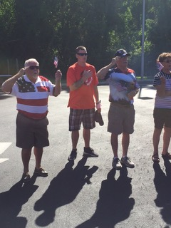 Participants in the VFW Calabash Post #7288 Independence Day Celebration singing the National Anthem, July 4th, 2018.