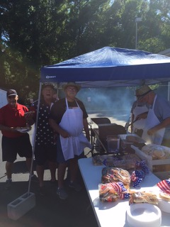 Members of VFW Calabash Post #7288 grilling and enjoying the grilled food at the Independence Day Celebration, July 4th, 2018.