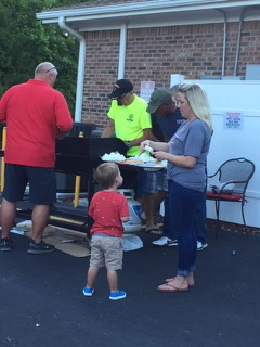 Guests of all ages making s'mores at the VFW Calabash Post #7288 Independence Day Celebration, July 4th, 2018.