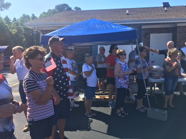 Participants paying respect to the flag as the National Anthem begins at the VFW Calabash Post #7288 Independence Day Celebration begins, July 4th, 2018.