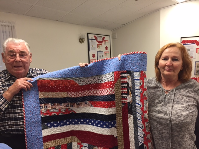 Jim Quigley was awarded a Quilt of Valor from Cathy Elliott.