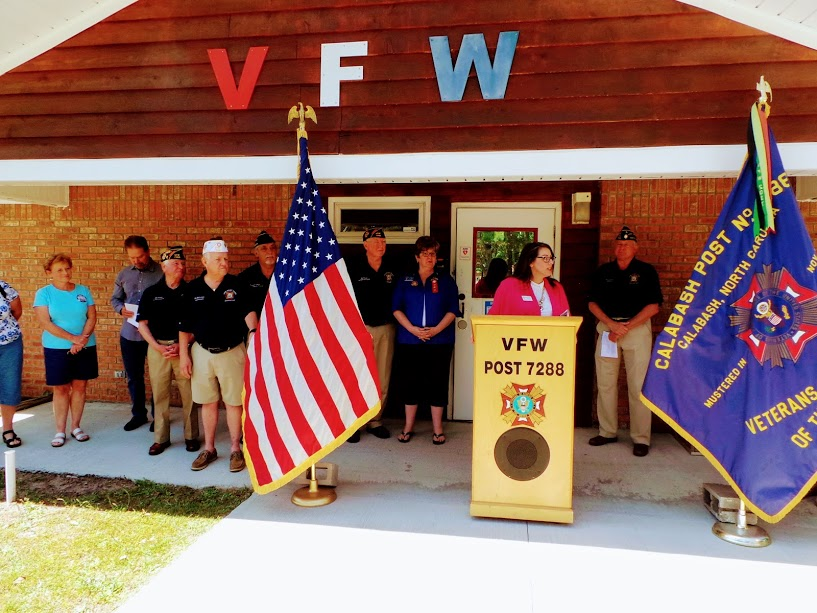 Brunswick County Chamber of Commerce President, Shannon Viero, addresses members of VFW Calabash Post #7288 during the ribbon cutting ceremony on May 1st, 2018.